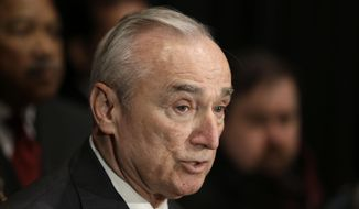 In this Jan. 7, 2015, file photo, New York City Police Commissioner Bill Bratton speaks to reporters after an NYPD swearing-in ceremony in New York. (AP Photo/Seth Wenig, File)