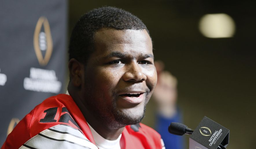 Ohio State quarterback Cardale Jones (12) smiles as he responds to questions during media day for the NCAA college football playoff championship, Saturday, Jan. 10, 2015, in Dallas. Ohio State is scheduled to play Oregon on Monday. (AP Photo/Tony Gutierrez)