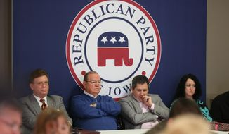 Iowa Republican Party members listen during a Jan. 10, 2015, meeting at the party headquarters in Des Moines to discuss whether the state party should carry on with a presidential straw poll. Despite criticism from some prominent Republicans, the Republican Party of Iowa's central committee unanimously voted to keep the event going. (Associated Press/The Des Moines Register, Charlie Litchfield) **FILE**
