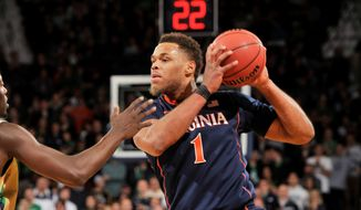 Virginia guard Justin Anderson posts up in the first half of an NCAA college basketball game with Notre Dame Saturday, Jan. 10, 2015, in South Bend, Ind. (AP Photo/Joe Raymond)
