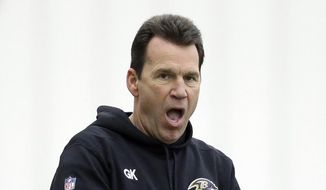 Baltimore Ravens offensive coordinator Gary Kubiak claps during an NFL football practice, Tuesday, Jan. 6, 2015, in Owings Mills, Md. The Ravens will travel to New England for a divisional playoff game against the Patriots on Saturday, Jan. 10. (AP Photo/Patrick Semansky)
