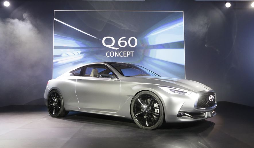 The Infiniti Q60 concept is unveiled at the Museum of Contemporary Art Detroit, Sunday, Jan. 11, 2015 in Detroit. Infiniti says the Q60 that will go on sale next year will be strongly influenced by the Q60 concept. (AP Photo/Carlos Osorio)
