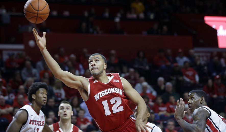 Wisconsin guard Traevon Jackson (12) shoots during the first half of an NCAA college basketball game against Rutgers, Sunday, Jan. 11, 2015, in Piscataway, N.J. (AP Photo/Mel Evans)