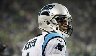 Carolina Panthers quarterback Cam Newton stands on the sideline during the second half of an NFL divisional playoff football game against the Seattle Seahawks in Seattle, Saturday, Jan. 10, 2015. (AP Photo/Ted S. Warren, file)