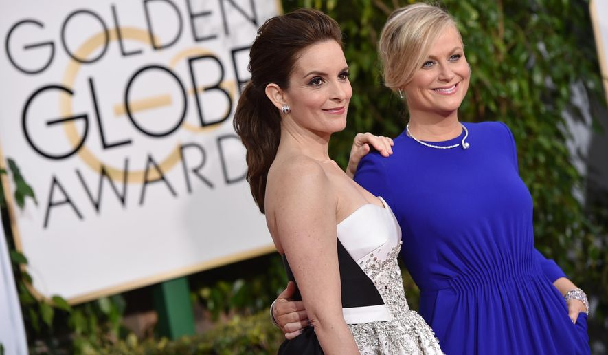 Tina Fey, left, and Amy Poehler arrive at the 72nd annual Golden Globe Awards at the Beverly Hilton Hotel on Sunday, Jan. 11, 2015, in Beverly Hills, Calif. (Photo by John Shearer/Invision/AP)