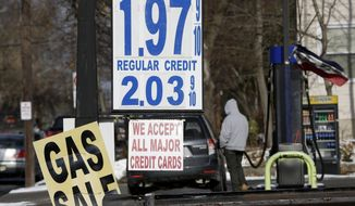 Gas prices under $2 a gallon are seen at a service station in Leonia, N.J., in this Jan. 9, 2015, file photo. (AP Photo/Seth Wenig, File)