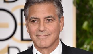"George Clooney wears a button reading ""Je suis Charlie"" at the 72nd annual Golden Globe Awards at the Beverly Hilton Hotel. Mr Clooney was honored with the Cecil B. DeMille lifetime achievement award. (Photo by John Shearer/Invision/AP)"