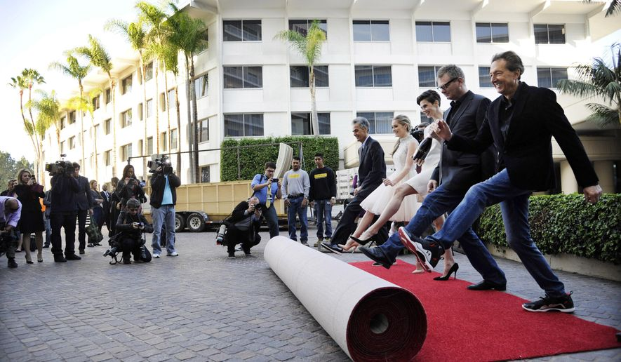 Barry Adelman, far right, executive producer of the 72nd Annual Golden Globe Awards, is joined by, left to right, fellow Golden Globes executive producer Allen Shapiro, Miss Golden Globe 2015 Greer Grammer, Moet Ambassador Elettra Wiedemann and Hollywood Foreign Press Association President Theo Kingma as they roll out the red carpet at the 72nd Annual Golden Globe Awards Preview Day at the Beverly Hilton on Thursday, Jan. 8, 2015, in Beverly Hills, Calif. The Golden Globe Awards will be held on Sunday, Jan. 11, 2015, at the Beverly Hilton. (Photo by Chris Pizzello/Invision/AP)