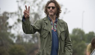 "Joaquin Phoenix stars as Larry ""Doc"" Sportello in ""Inherent Vice.""   (AP Photo/Warner Bros. Pictures, Wilson Webb)"