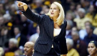 Maryland head coach Brenda Frese gives instructions to her team during an NCAA college basketball game at Williams arena, Sunday, Jan. 11, 2015 in Minneapolis. Maryland defeated Minnesota 77-73. (AP Photo/The Star Tribune, Jerry Holt) ST. PAUL PIONEER PRESS OUT, MINNEAPOLIS-AREA TV OUT, MAGS OUT
