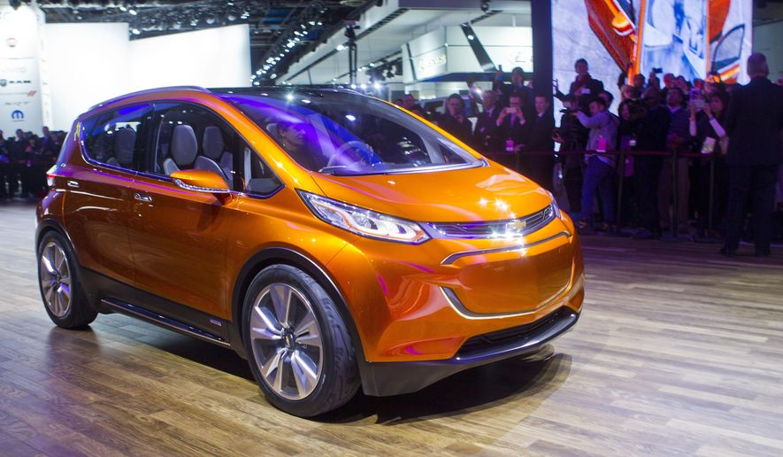 The Chevrolet Bolt EV electric concept vehicle is driven onto the stage at a presentation during the North American International Auto Show, Monday, Jan. 12, 2015, in Detroit. (AP Photo/Tony Ding)