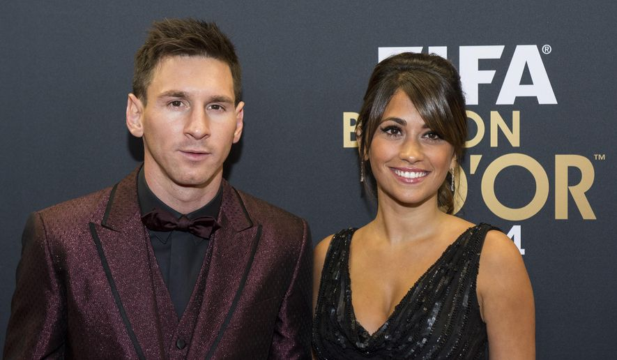 Lionel Messi of Argentina and his wife arrive on the red carpet prior to the FIFA Ballon d'Or 2014 gala held at the Kongresshaus in Zurich, Switzerland, Monday, January 12, 2015. (AP Photo/KEYSTONE,Ennio Leanza)