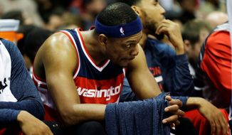 The Wizards' Paul Pierce sits on the bench in his team's blowout loss to the Atlanta Hawks on Sunday. The Wizards face a similar high-powered team in the San Antonio Spurs at home on Wednesday. (Associated Press)