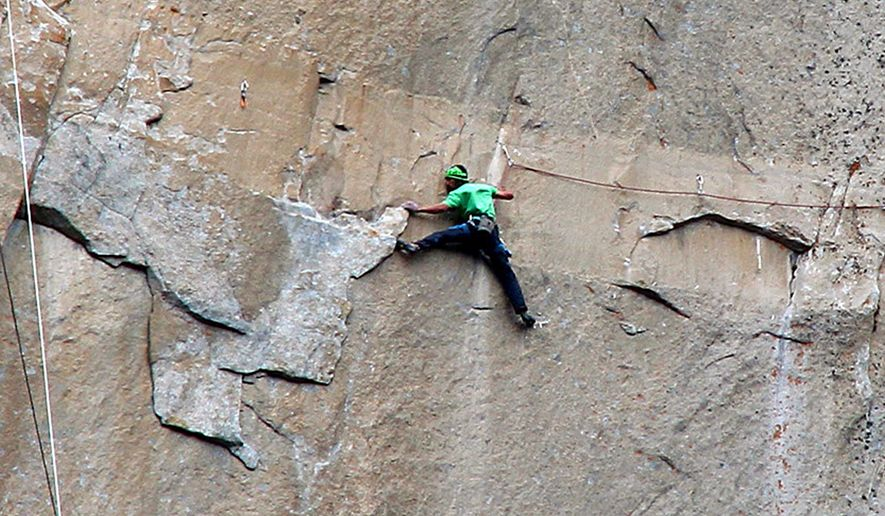 In this Jan. 9, 2015 photo provided by Tom Evans, Kevin Jorgeson climbs on what is known as pitch 15 during what has been called the hardest rock climb in the world: a free climb of El Capitan, the largest monolith of granite in the world, a half-mile section of exposed granite in California's Yosemite National Park. The first climber reached its summit in 1958, and there are roughly 100 routes up to the top. (AP Photo/Tom Evans, elcapreport)