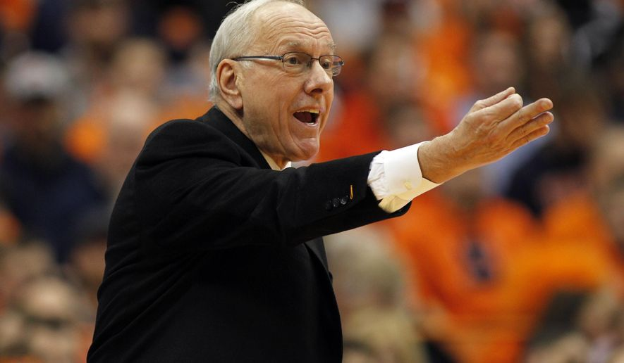 Syracuse head coach Jim Boeheim yells to his players in the second half of an NCAA college basketball game in Syracuse, N.Y., Sunday, Jan. 11, 2015. Syracuse won 70-57. (AP Photo/Nick Lisi)