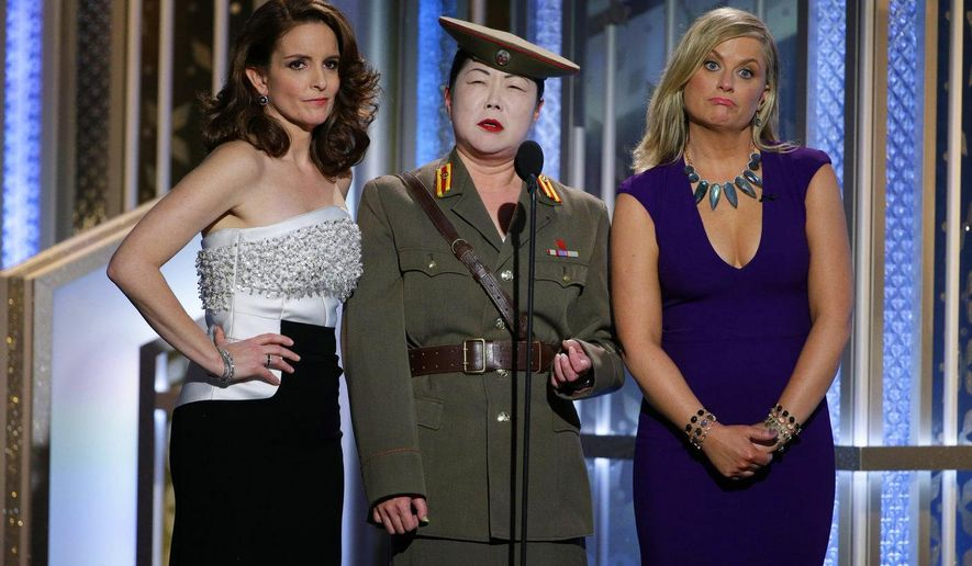 In this image released by NBC, Tiny Fey, from left, Margaret Cho and Amy Poehler speak at the 72nd Annual Golden Globe Awards on Sunday, Jan. 11, 2015, at the Beverly Hilton Hotel in Beverly Hills, Calif. (AP Photo/NBC, Paul Drinkwater)