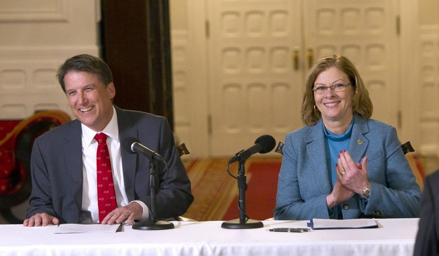 Gov. Pat McCrory, left, and Raleigh Mayor Nancy McFarlane smile as they announce that an agreement has been reached between the City of Raleigh and the State of N.C. on the sale of Dix property during a press conference held at the Governor's Mansion in Raleigh on Monday Jan.  12, 2015  It was announced that the city will buy the 307 acre property for $52 million. (AP Photo/The News & Observer, Chris Seward)