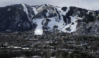 This Dec. 1, 2014 photo shows the Aspen Mountain ski area by Aspen, Colo. Resort towns like Aspen dramatically demonstrate an unnerving trend: Across the country, the rich are getting richer while the rest of the country is essentially treading water. (AP Photo/John Locher)