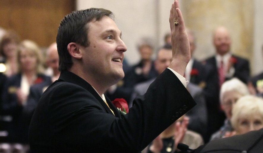 Arkansas House Speaker Jeremy Gillam, R-Judsonia, waves after being sworn in at the Arkansas state Capitol in Little Rock, Ark., Monday, Jan. 12, 2015. (AP Photo/Danny Johnston)