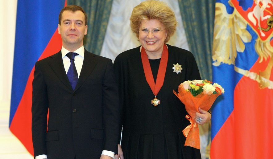 FILE - In this Monday Dec. 28, 2009 file pool photo, the then Russian President Dmitry Medvedev, left, and mezzo-soprano Elena Obraztsova pose for a photo during an award ceremony at Yekaterininsky (St. Catherine's) hall in the Moscow Kremlin. Obraztsova died Monday, Jan. 12, 2015, in Germany, where she was undergoing medical treatment. She was 75. (AP Photo/ RIA Novosti, Mikhail Klimentyev, Presidential Press Service, pool, file)