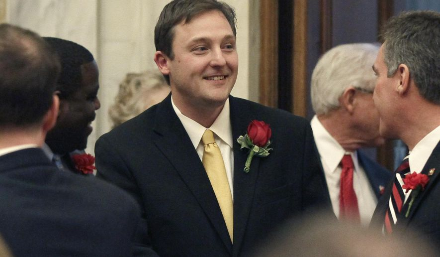 Rep. Jeremy Gillam, R-Judsonia, is greeted by other House members on the floor of the House of Representatives at the Arkansas state Capitol in Little Rock, Ark., Monday, Jan. 12, 2015. Gillam was elected House Speaker Monday, the first day of the 90th General Assembly. (AP Photo/Danny Johnston)