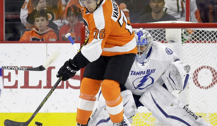 Philadelphia Flyers' Chris Vande Velde, left, scores a goal against Tampa Bay Lightning's Evgeni Nabokov, of Kazakhstan, during the first period of an NHL hockey game, Monday, Jan. 12, 2015, in Philadelphia. (AP Photo/Matt Slocum)