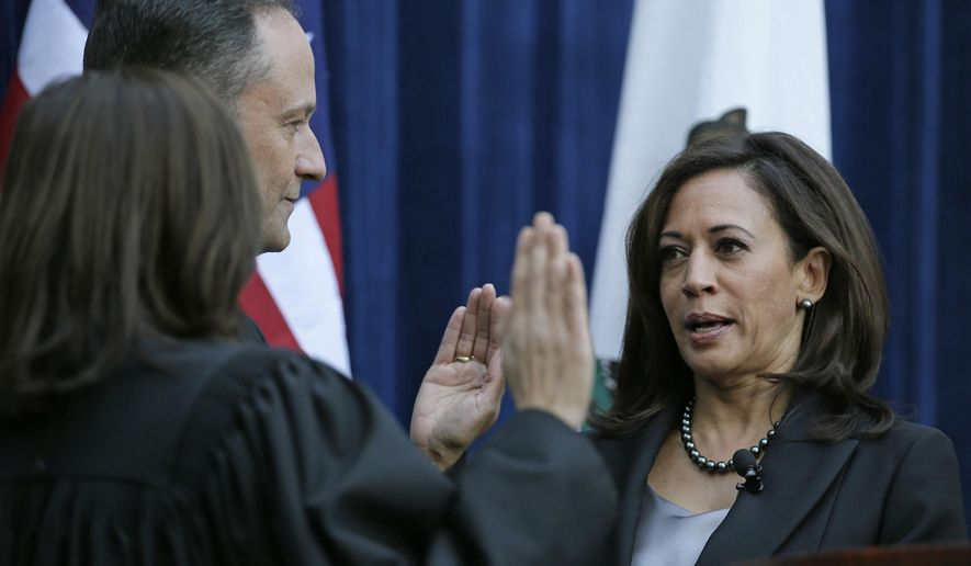 FILE - In this Monday, Jan. 5, 2015, file photo, California Attorney General Kamala Harris, right, takes the oath of office from California Supreme Court Chief Justice Tani Cantil-Sakauye, left, as her husband, Douglas Emhoff, looks on at the Crocker Art Museum in Sacramento, Calif. An adviser with knowledge of her plans says California Attorney General Kamala Harris will announce Tuesday, Jan. 13, 2015 that she will seek the U.S. Senate seat being vacated by Sen. Barbara Boxer. (AP Photo/Eric Risberg, File)