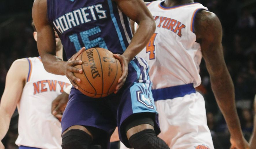 Charlotte Hornets' Kemba Walker (15) drives past New York Knicks' Quincy Acy (4) during the first half of an NBA basketball game Saturday, Jan. 10, 2015, in New York. (AP Photo/Frank Franklin II)