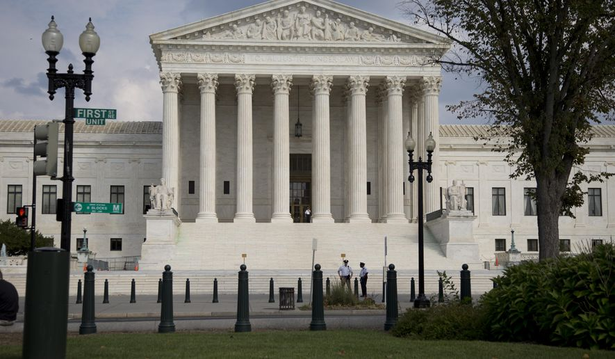 The Supreme Court Building is shown in this, Thursday, Sept. 18, 2014, file photo in Washington. A small church in a Phoenix suburb says its local government puts far stricter limits on its roadside signs advertising Sunday services than it places on politicians, real estate agents and other groups, and is asking the Supreme Court for relief. The justices are hearing arguments Monday in a case from Gilbert, Arizona, that raises First Amendment questions about how governments may regulate their citizens' speech. (AP Photo/Carolyn Kaster)