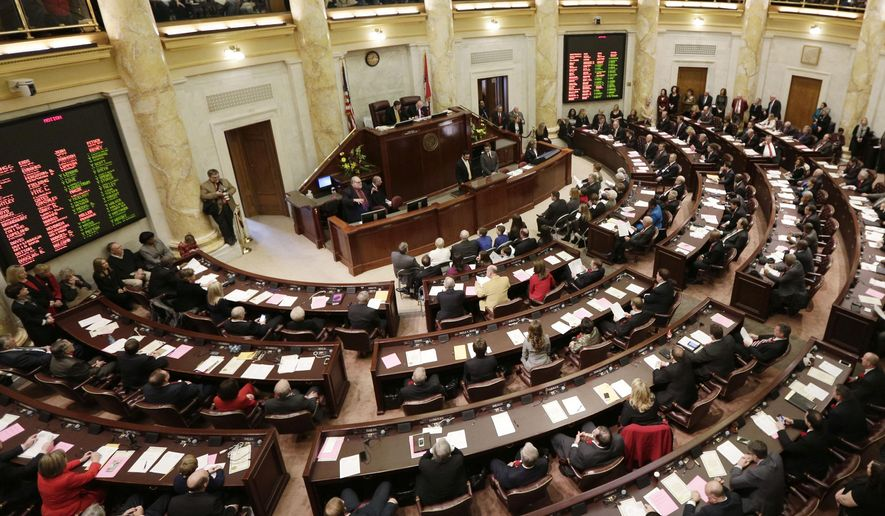 Members of the Arkansas House of Representatives meet in the House chamber at the Arkansas state Capitol in Little Rock, Ark., Monday, Jan. 12, 2015, the first day of the 2015 legislative session. (AP Photo/Danny Johnston)