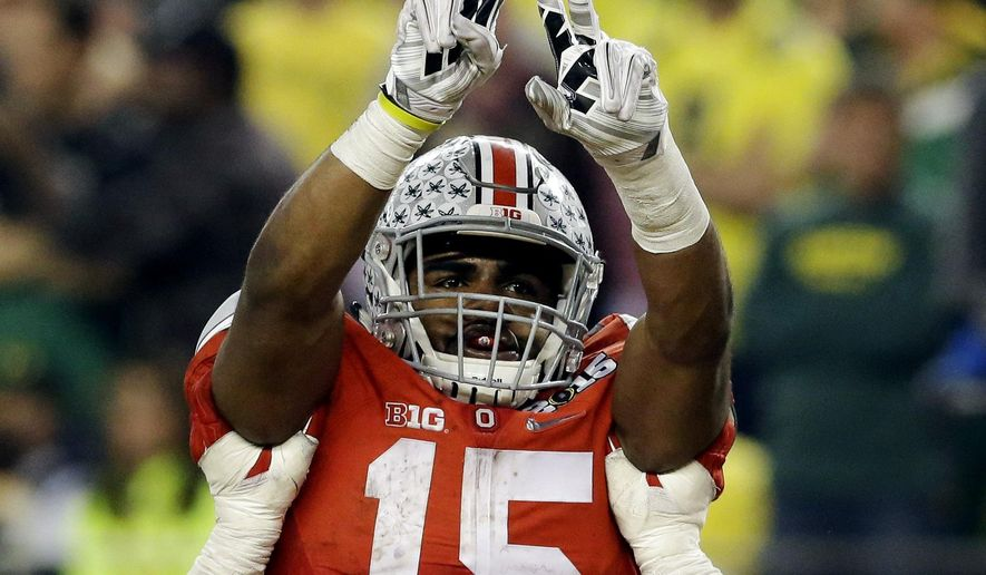 Ohio State's Ezekiel Elliott (15) celebrates after a nine-yard touchdown run during the second half of the NCAA college football playoff championship game against Oregon Monday, Jan. 12, 2015, in Arlington, Texas. (Associated Press)