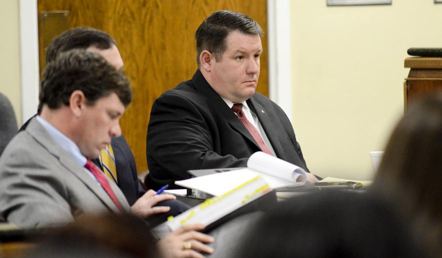 Former Eutawville Police Chief Richard Combs, right,  listens as opening statements are given in the first day of testimony of his murder trial in Orangeburg, S.C. Combs is charged with murder for the shooting of Bernard Bailey, an unarmed black man. (AP Photo/Times & Democrat, Larry Hardy)