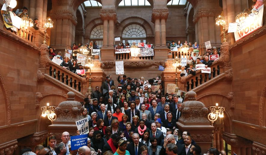 Supporters of public education rally on the Great Western Staircase at the state Capitol on Monday, Jan. 12, 2015, in Albany, N.Y. (AP Photo/Mike Groll)