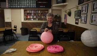 A federal judge on Monday ruled in favor of Nancy Rosenbrahn of Rapid City and other gay plaintiffs seeking the right to legally marry in South Dakota. In this file photo, Ms. Rosenbrahn was assembling decorations in preparation for a multiple couples wedding reception at the Moose Lodge in Rapid City in June. (AP Photo/Toby Brusseau)