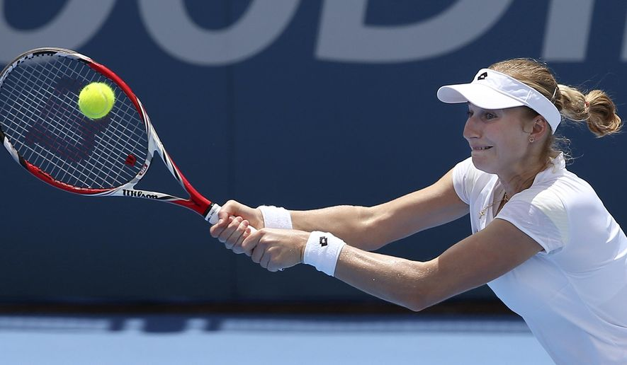 Ekaterina Makarova of Russia plays a shot to  Carla Suarez Navarro of Spain during their match at the Sydney International tennis tournament in Sydney, Tuesday, Jan. 13, 2015. (AP Photo/Rick Rycroft)