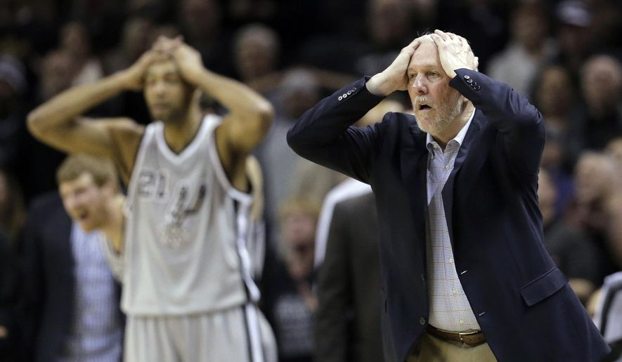 San Antonio Spurs head coach Gregg Popovich, right, and Tim Duncan, left, react to a call during the second half of an NBA basketball game against the Phoenix Suns, Friday, Jan. 9, 2015, in San Antonio. San Antonio won 100-95. (AP Photo/Eric Gay)