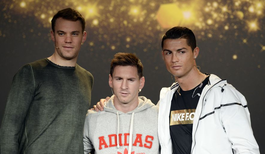 Manuel Neuer of Germany, Lionel Messi of Argentina and Cristiano Ronaldo of Portugal, from left, the nominees for the FIFA Ballon d'Or 2014 award, attend a press conference prior to the FIFA Ballon d'Or awarding ceremony at the Kongresshaus in Zurich, Switzerland, Monday, Jan. 12, 2015. (AP Photo/Keystone, Walter Bieri)