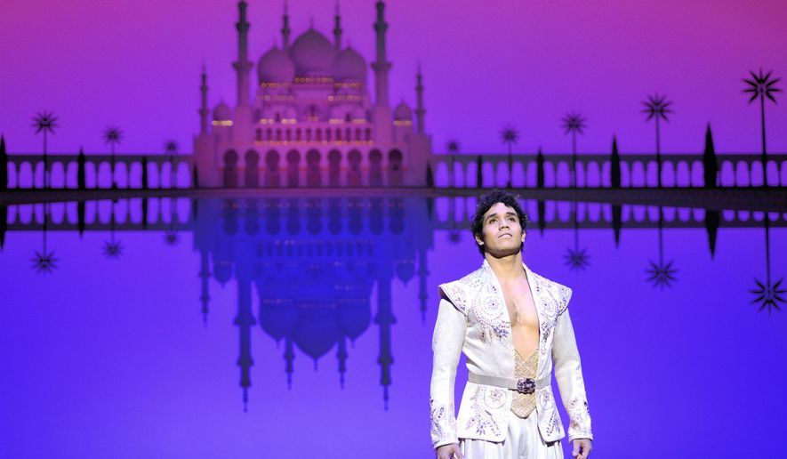 "In this Dec. 19, 2013 photo released by Disney Theatrical Productions, Adam Jacobs performs in the musical ""Aladdin,"" at the Ed Mirvish Theatre in Toronto, Canada. Jacobs will help represent the show Thursday when it appears as an entire category of answers on the quiz game show ""Jeopardy!"" The game show has long given Broadway a boost since its debut in 1984, offering such categories as ""Broadway Musicals"" and ""Pop Singers on Broadway."" (AP Photo/Disney Theatrical Productions, Deen van Meer)"