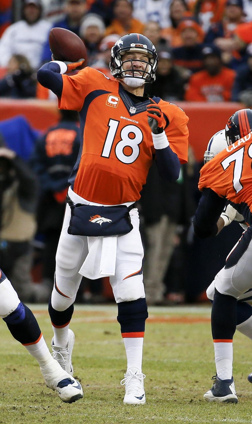 Denver Broncos quarterback Peyton Manning throws against the Indianapolis Colts during the first half of an NFL divisional playoff football game, Sunday, Jan. 11, 2015, in Denver. (AP Photo/Jack Dempsey)