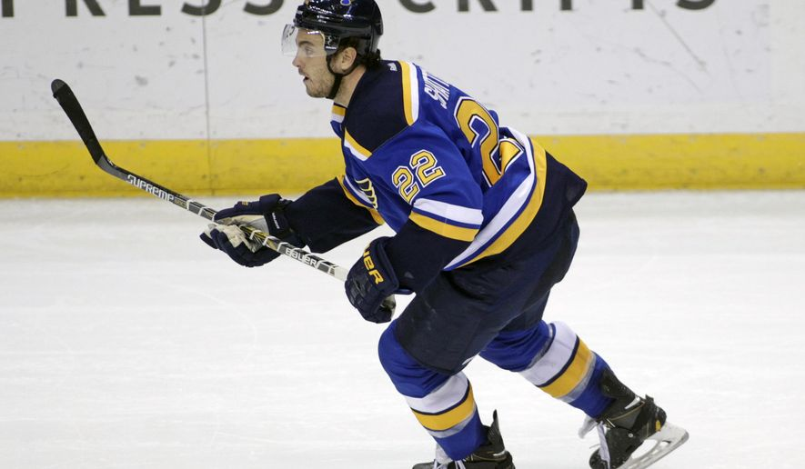 St. Louis Blues defenseman Kevin Shattenkirk (22) skates in the third period of an NHL hockey game against the Carolina Hurricanes, Saturday, Jan. 10, 2015 in St. Louis. Shattenkirk joins teammate Vladimir Tarasenko in being named to this season's All-Star team. (AP Photo/Tom Gannam)