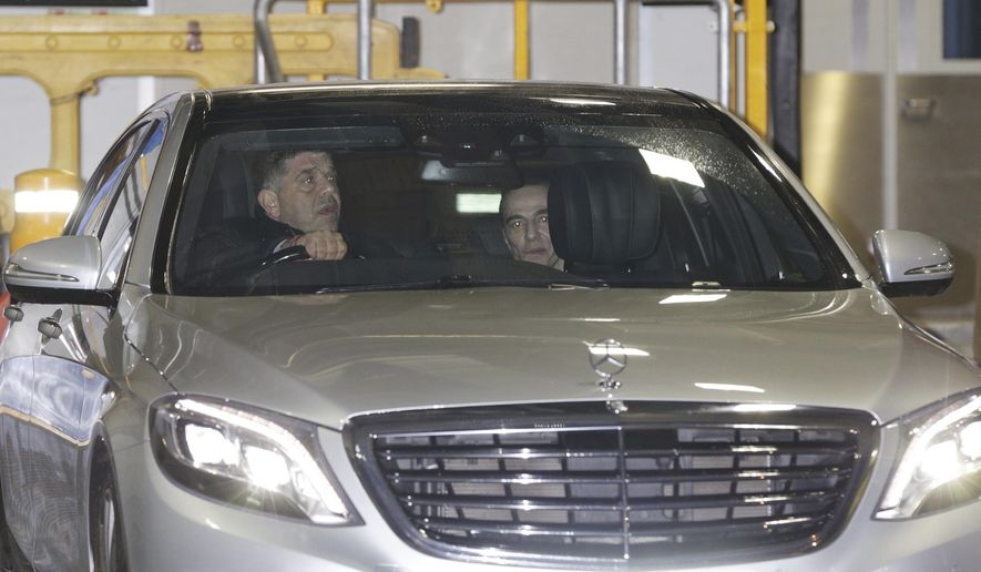 Fashion designer John Galliano, right, is driven away in a car after he returned with a debut fashion show to a select invited audience for fashion house Maison Martin Margiela, in central London Monday Jan. 12, 2015.  This event marks the return of the designer to the world of fashion after he made anti-Semitic comments in a Paris bar in 2011,  resulting in being dismissed from Christian Dior, and was convicted by a French court on complaints of anti-Semitic behavior. (AP Photo / Yui Mok, PA) UNITED KINGDOM OUT - NO SALES - NO ARCHIVES