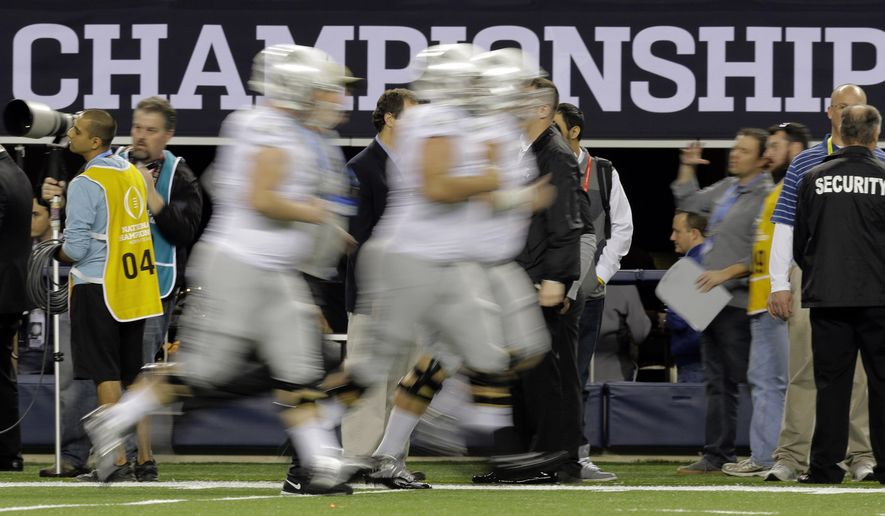 Oregon players warm up before the NCAA college football playoff championship game against Ohio State Monday, Jan. 12, 2015, in Arlington, Texas. (AP Photo/Eric Gay)