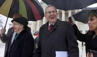 Good News Community Church Pastor Clyde Reed, center, smiles as he leaves the Supreme Court in Washington, Monday, Jan. 12, 2015, with his wife Ann, left. The Supreme Court appears likely to side with a small church in its fight with a Phoenix suburb over limits on roadside signs directing people to Sunday services. Liberal and conservative justices expressed misgivings Monday with the Gilbert, Arizona, sign ordinance because it places more restrictions on the churches' temporary signs than those erected by political candidates, real estate agents and others. The Good News Community Church sued over limits that Gilbert places on so-called directional signs, like the ones the church places around town to point people to its services in local schools and retirement communities. (AP Photo/Susan Walsh)