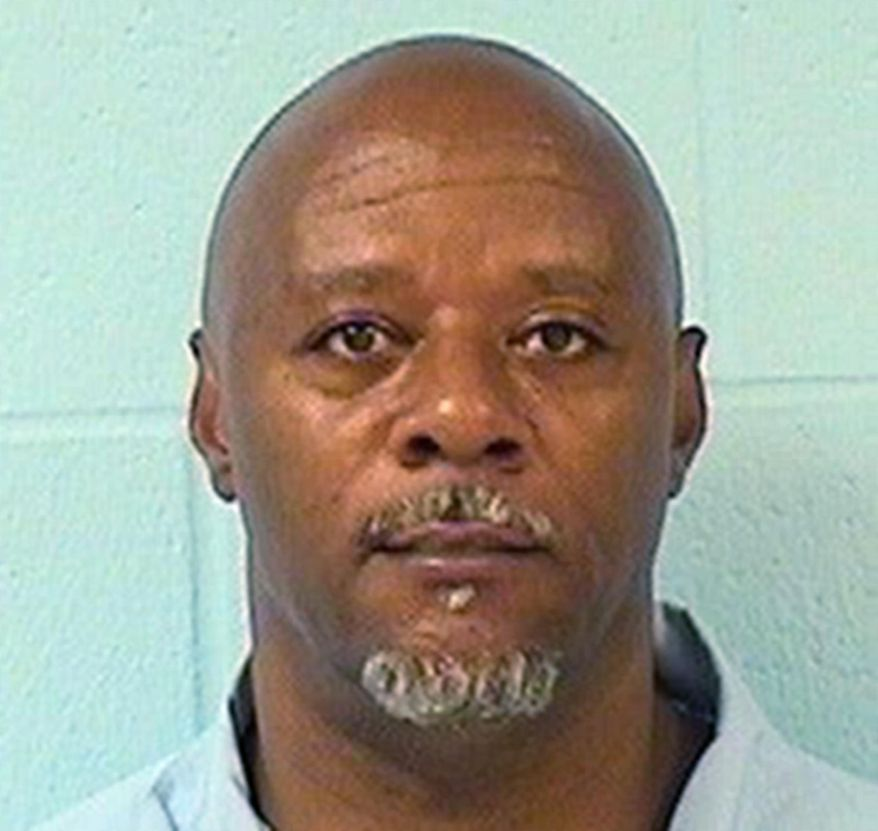 This undated photo provided by the Illinois Department of Corrections shows Tyrone Hood. Hood was convicted in the 1993 shooting death of an Illinois Institute of Technology basketball player. In his final moments as Illinois governor, Pat Quinn granted clemency to 43 people, commuted the sentences of Hood and five other people, and pardoned another based on innocence,  his office announced Monday, Jan. 12, 2015 in Chicago. (AP Photo/Illinois Department of Corrections)