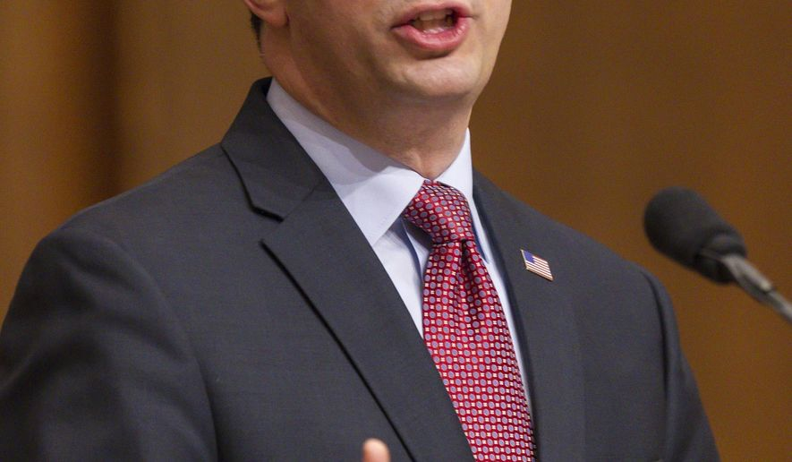 Wisconsin Gov. Scott Walker, center front, addresses a joint session of the state Legislature during the Governor's State of the State speech in the Assembly chambers at the state Capitol, Tuesday, Jan. 13, 2015, in Madison, Wis. (AP Photo/Andy Manis)