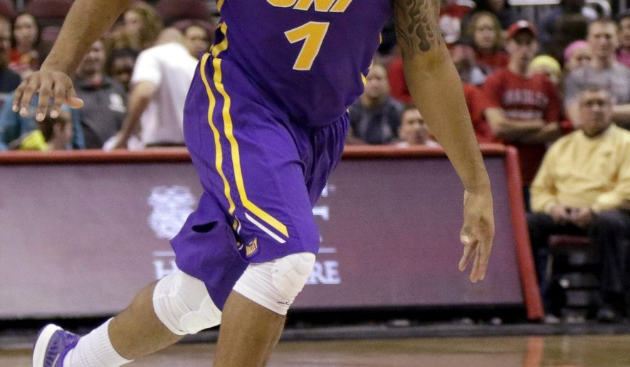 Northern Iowa guard Deon Mitchell (1) moves the ball down the court against Bradley during the first half of an NCAA college basketball game at Carver Arena Tuesday, Jan. 13, 2015, in Peoria, Ill. (AP Photo/ Stephen Haas)