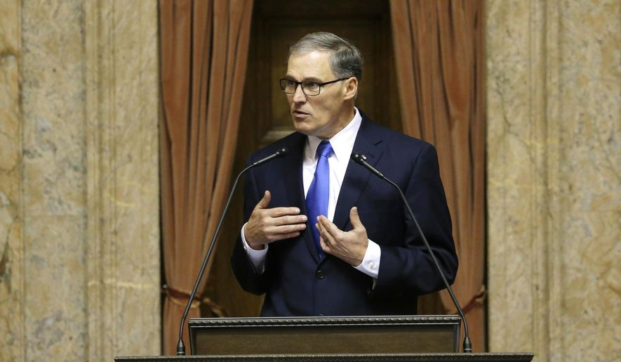 Washington Gov. Jay Inslee gives his annual State of the State speech Tuesday, Jan. 13, 2015, to a joint session of the Washington Legislature in Olympia, Wash. Inslee said Washington state has a moral obligation to address carbon pollution to tout his recent proposal for a cap-and-trade program that requires the largest industrial polluters to pay for every ton of carbon they release. (AP Photo/Ted S. Warren)