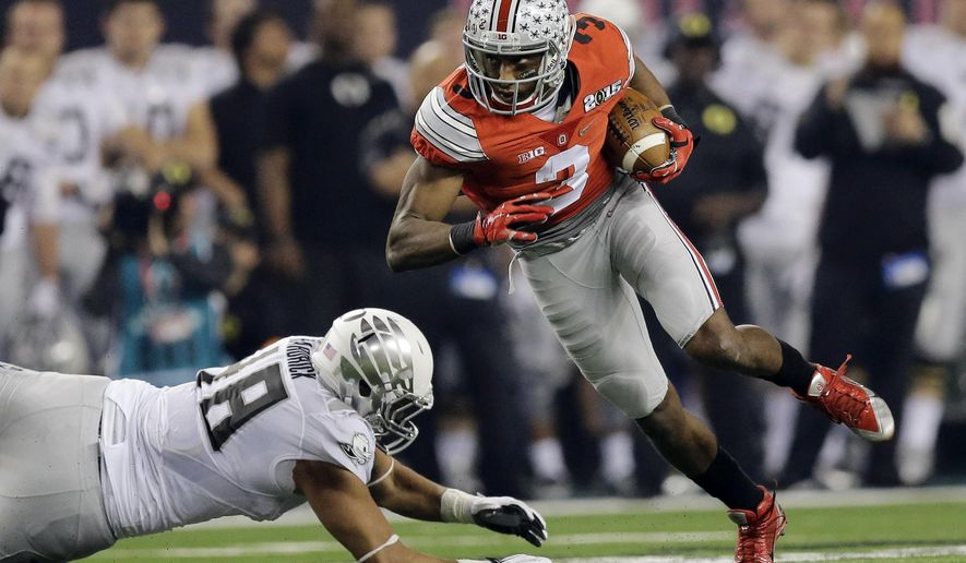 Ohio State's Michael Thomas catches a pass during the first half of the NCAA college football playoff championship game against Oregon Monday, Jan. 12, 2015, in Arlington, Texas. (AP Photo/Eric Gay)