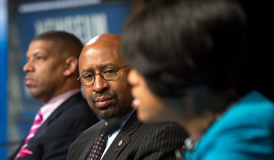 Sacramento, California, Mayor Kevin Johnson (left) and Philadelphia Mayor Michael Nutter (center) listen as Baltimore Mayor Stephanie Rawlings-Blake speaks Tuesday at the President's Task Force on 21st Century Policing at the Newseum in Washington. (associated press)