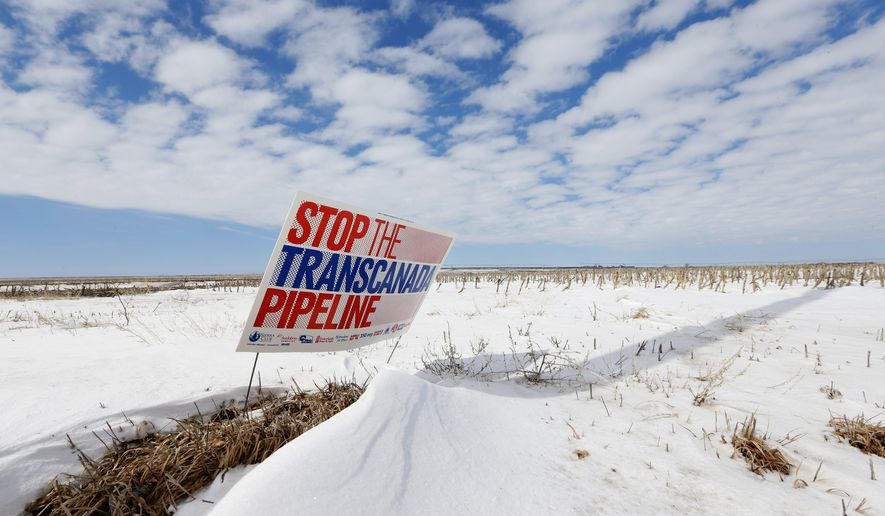 "In this March 11, 2013 file photo is a sign reading ""Stop the Transcanada Pipeline"" placed in a field near Bradshaw, Neb. Even if the Republican-led Congress approves the Keystone XL pipeline, not a drop of oil will flow through the system until Nebraska signs off on its route. The routing process is still before the state Supreme Court, and depending on how justices rule, it could be months or longer before any construction in Nebraska begins. (Associated Press)"